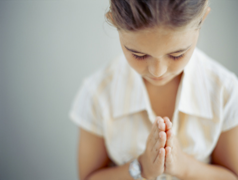 close-up of a girl in a praying position